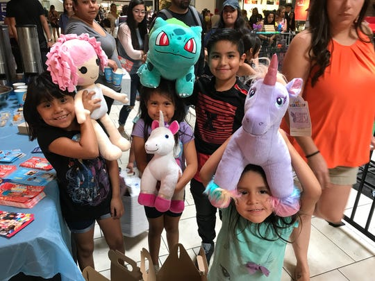 Dyvinity Duchene, 7, from left, Delilah Duchene, 5, Calorego Martinez, 9, and Danyka Duchene, 3, were all smiles when they walked out of Build-A-Bear on Thursday at Cielo Vista Mall.