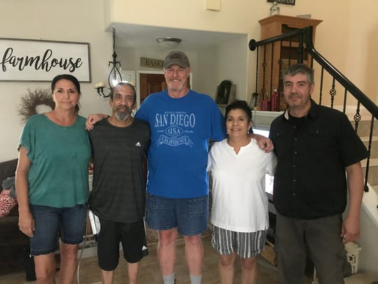 Ernie Armijo (far left) stands with his family for