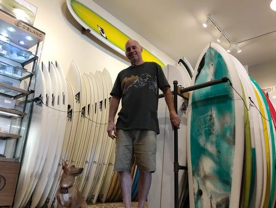 Craig Gordon and his dog, Bullitt, at Gordon's Surf