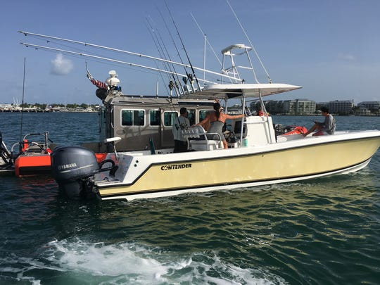 Three Cuban migrants were rescued more than 40 miles off Key West on July 7. James Fitzek, of Golden Gate Estates, and Capt. Don Hiller of the Monroe County Sheriff's Office got the men on their boats and took them to shore.