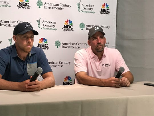 Joe Pavelski, left, and John Smoltz discuss their rounds