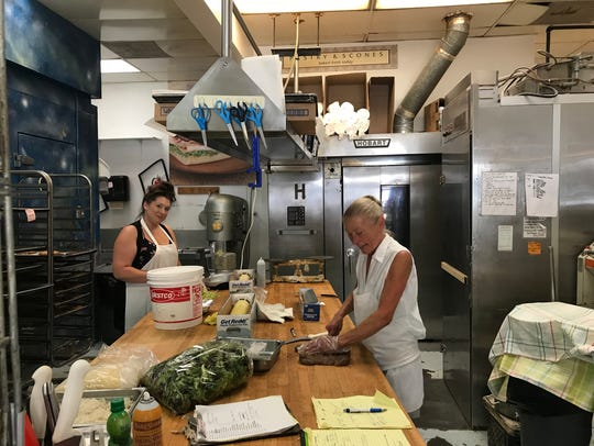 Rachael Olsen (left) and Nadine Obernolte (right) work on prep at Croissant & Company.