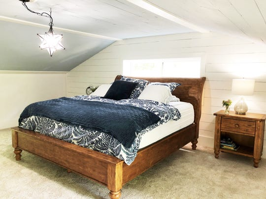 Homeowners Katie Beeler Henson and Stewart Henson put their own touches on a tired ranch – adding shiplap style boards over the drywall and converting this loft space into a light and airy master bedroom.