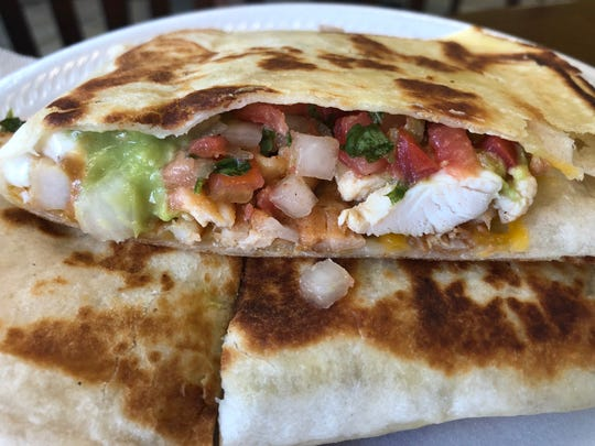 The Chicken Quesadilla at Oscar's Taco Shop is a hearty portion full of fresh ingredients.