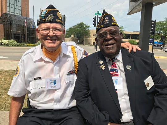 Oshkosh Post Commander Francis Mathe and former Department Vice Commander Ensley Brown relax outside the Oshkosh Convention Center.