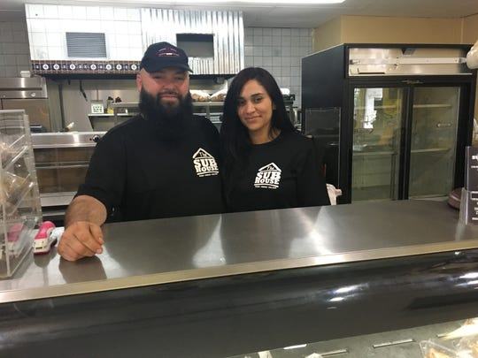 Mario Fonseca, pictured here with his wife, Jennifer Cruz, owns The Sub House in Fort Myers.