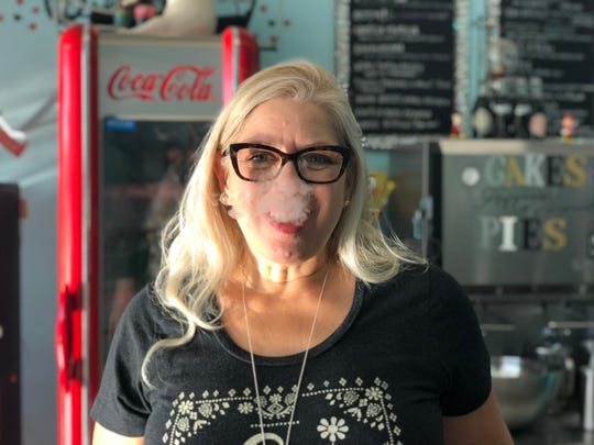 "Alicia Perez, owner of the new Best Ice Cream Land in south Fort Myers, tastes her ""giggly popcorn"" which is made with liquid nitrogen."