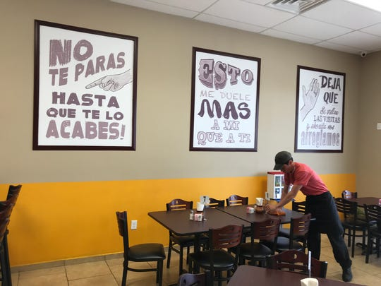 "The first saying on the wall says, ""Don't get up until you finish it."""
