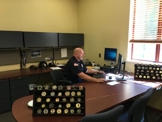 Lt. Mark Garry works to catch up on his first day back at the station.
