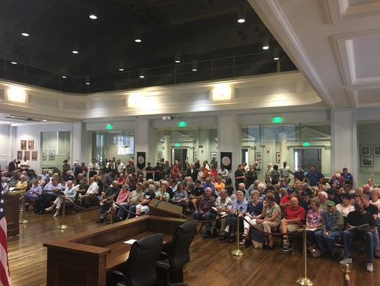 Retirees packed the City Council auditorium on July