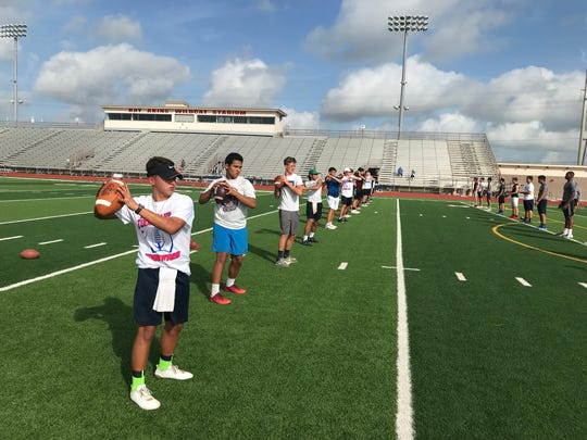 High school level quarterbacks throw during a drill at the Todd Dodge Football Camp hosted at Gregory-Portland's Ray Akins Wildcat Stadium on Tuesday, July 17, 2018.