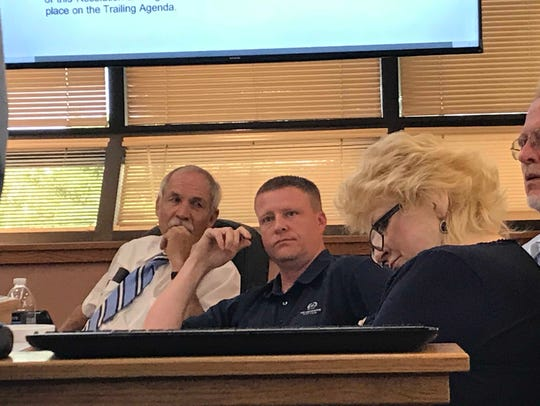 County Commissioner John Henry asks pointed questions