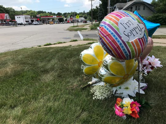 A makeshift memorial faces Dairy Queen and the Racine Avenue intersection where 6-year-old Logan Smith on a bicycle lost his life on July 14. The boy and his mother were struck as they were crossing the road near Cheviot Chase after a trip to the restaurant for ice cream.