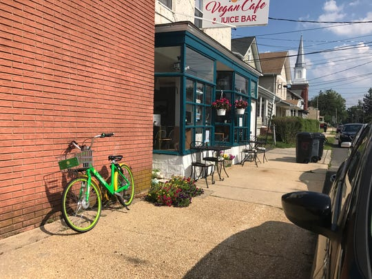 A LimeBike parked in front of a cafe on Main Street in Keyport.