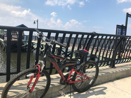 A personal bike locked to the fence at the Keyport Waterfront.