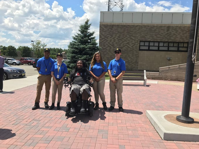 The Explorer Volunteers with Eric LeGrand.