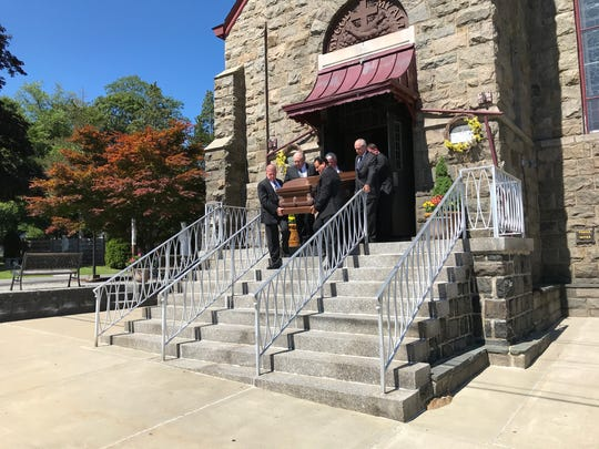 The casket of the Rev. William Scully, O.F.M. is carried out of St. Anthony of Padua in Butler on Thursday, July 19, 2018. Father Bill died at the age of 78 after a long life of service with the Catholic church.