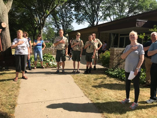 Eagle Scout Jake Dunn leads a group in the Pledge of Allegiance after raising the flag.