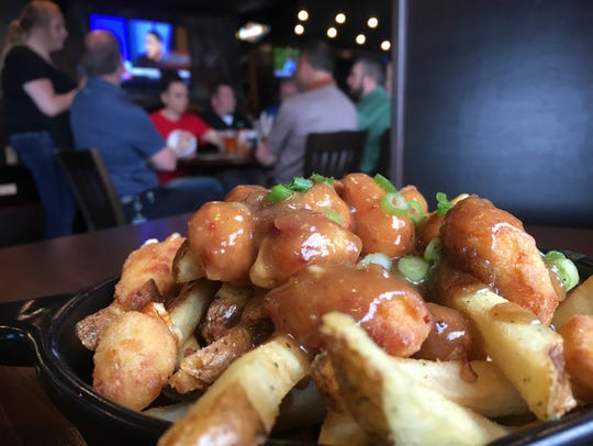 Crooked Pint's poutine comes covered in beef gravy