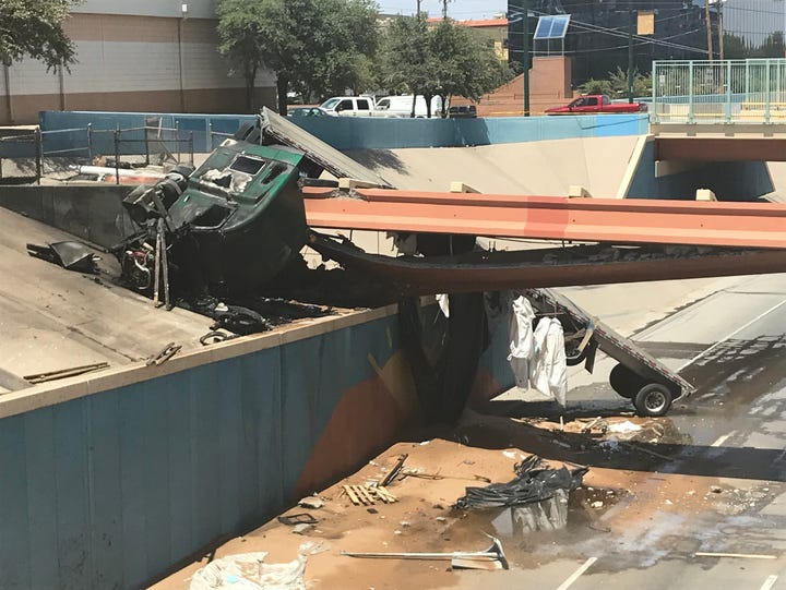 A tractor-trailer smashed into an Interstate 10 overpass