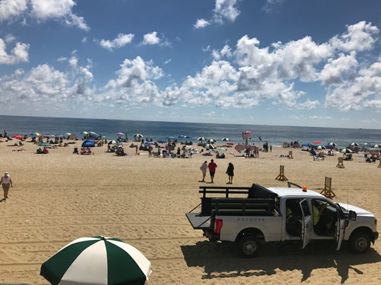 The beach at Pier Village remains crowded on Friday despite concerns.