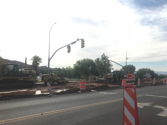 Construction crews work on a road project in St. George