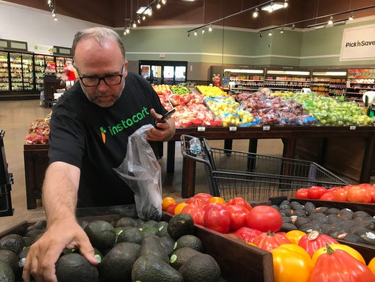 Keith Janicke of Instacart fills an order at Pick 'n