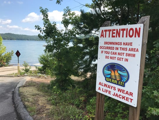 Warning signs are posted in areas of Lake Keowee to