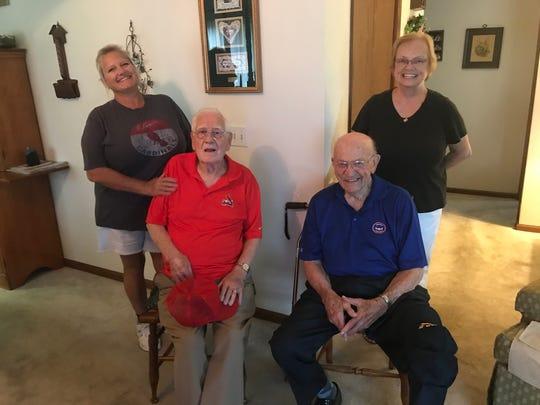 Bud Everhart, left, with daughter Kristy Everhart, and Gene Sweeney with daughter Elizabeth Anders.