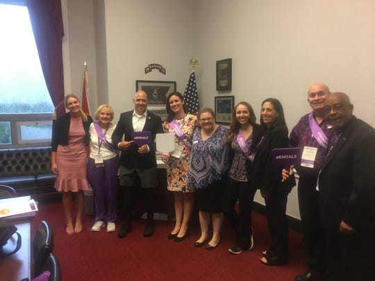 Congressman Brian Mast, third from left, with Alzheimer's