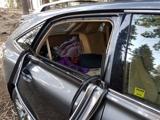 Photo shot July 19, 2018 of bear damage to a vehicle