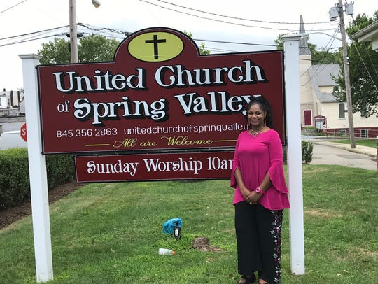 The interim pastor, the Rev. Terri Ofori, stands outside the United Church of Spring Valley.