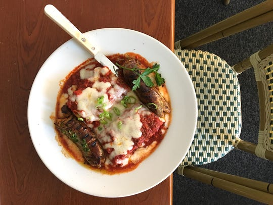 A lunch special featuring polenta baked with meat sauce