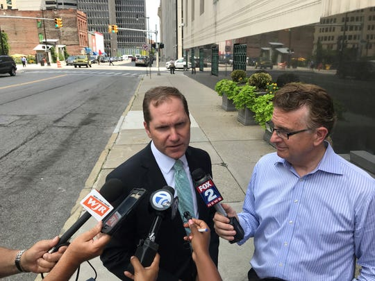 Matthew Schneider, United States Attorney, speaking to the media outside of the courthouse on July 25, 2018.