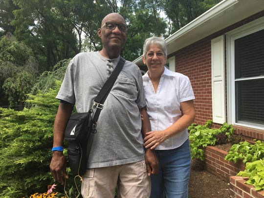 Tom and Gail Davis stand in front of their Staunton
