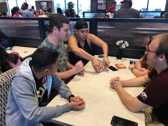 People brought cards and board games to entertain themselves while they camp out for 24 hours at the newest Chick-fil-A on Airway Boulevard. The campout is for the grand opening on Thursday.