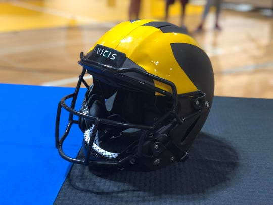 A VICIS ZERO1 football helmet in Golden West colors.