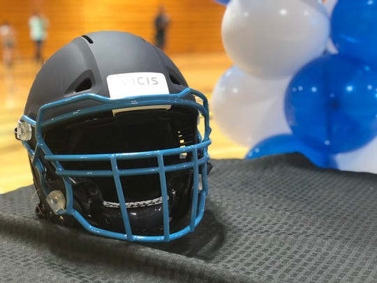A VICIS ZERO1 football helmet in Redwood colors.