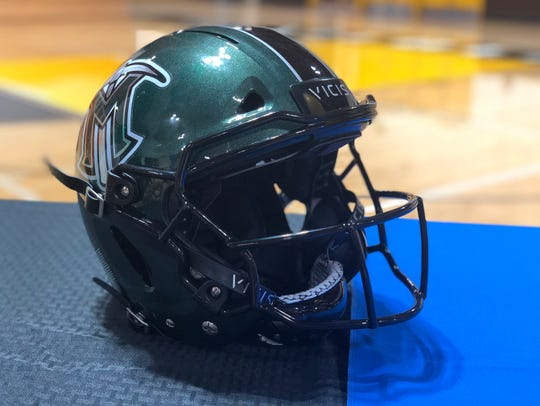 A VICIS ZERO1 football helmet in El Diamante colors.