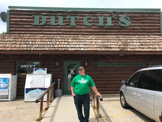 Chad Wegner stands outside Dutch's Trading Post, 258