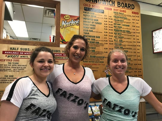 Owner Jessi Crowe (middle) and two of the 16 employees that keep Fatzo's running, Kati Knitter (left) and Shelly Pritzl (right).