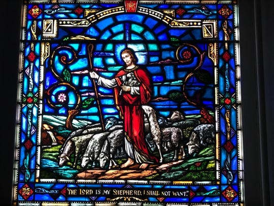 A stained-glass window in the sanctuary at United Church of Spring Valley