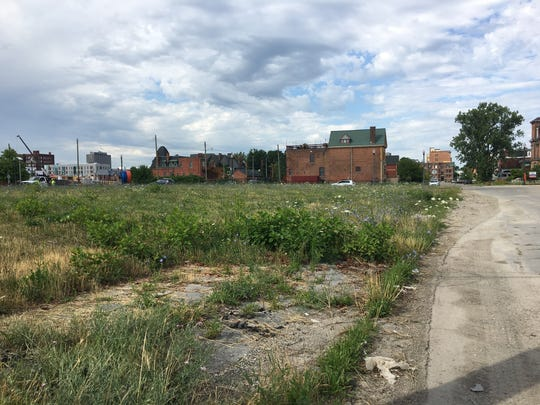 This grassy lot in Brush Park will be the site of new housing construction.