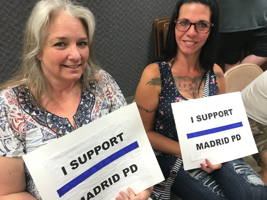 Madrid resident Cristina Meeker, left, and Lindsey Burke were among more than 150 people in Thursday's special meeting to consider terminating Police Chief Rick Tasler