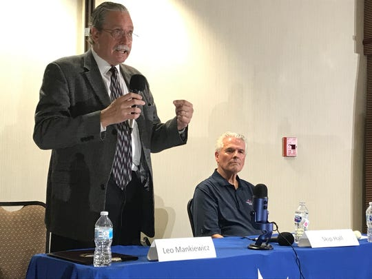 Leo Mankiewicz and Skip Hall debate the issues at a Surprise City Council candidates forum in July 2018.
