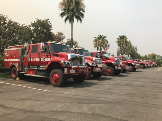 On July 26, fire trucks were parked outside the Best Western Plus Hilltop Inn in Redding. Area hotels were filling up with firefighters and evacuees from the Carr Fire.