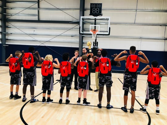 Boys received new Nike backpacks for winning the championship.
