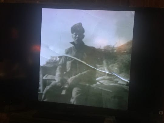 A photo of Art Cooke during the Korean War from a slideshow