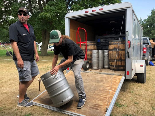 Witch's Hat Brewing Co. sales manager Jon Cole, left,