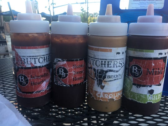 Four barbecue sauce options are available at Butcher's
